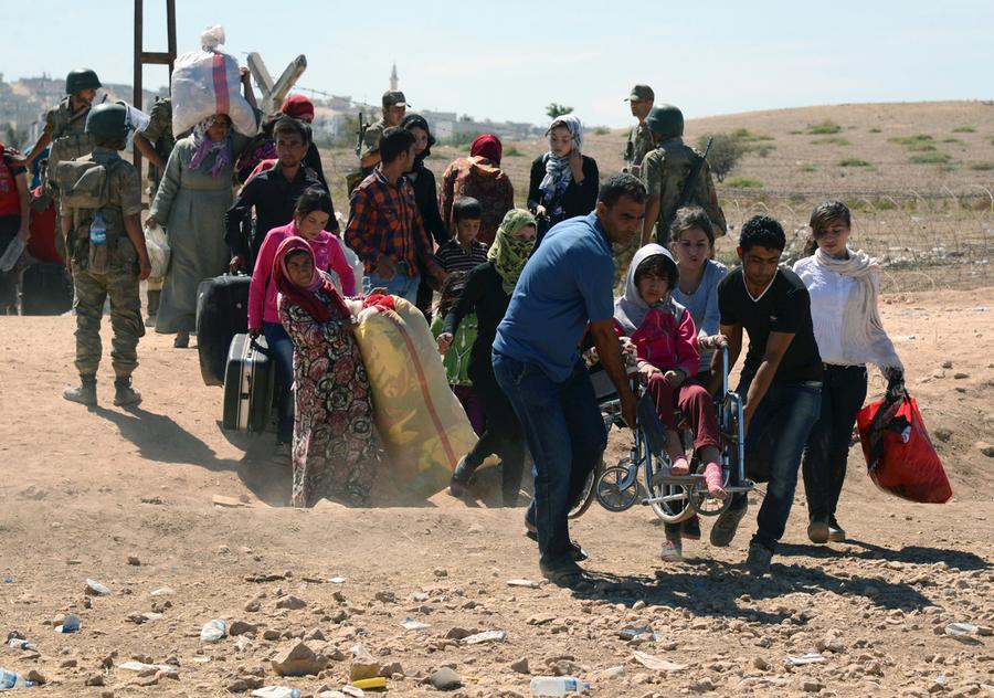 Suriye'deki savaştan kaçarak Türkiye'ye gelen Suriyeli göçmenler